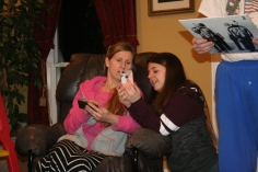 Mom has a new phone and Katelyn is teaching her how to use it.
